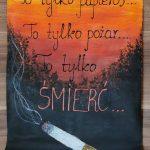 Plakat przedstawia niedopałek papierosa